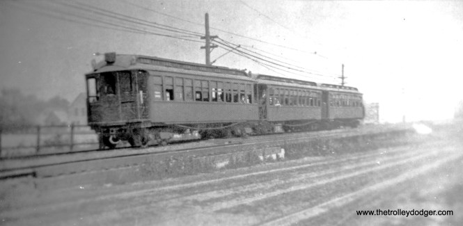 "Here. a wooden ""L"" car train descends the ramp near Laramie on the Lake Street ""L"". This must be an early photo, as it looks like Lake Street is unpaved. Streetcar service was extended west to Harlem Avenue here by the Cicero & Proviso in 1891. Chicago Railways took over the city portion in 1910. Service west of Austin Boulevard was provided by the West Towns Railways."
