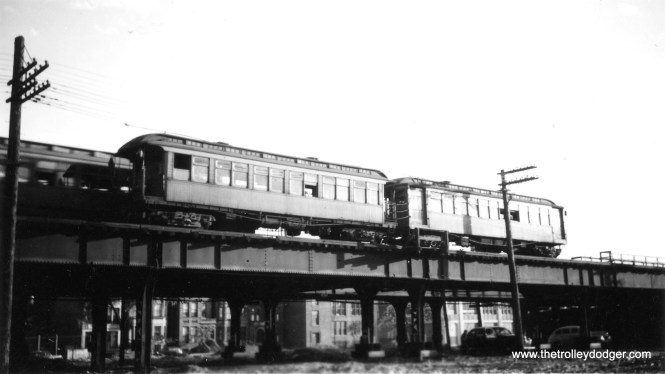 "This is Racine Avenue on the Metropolitan ""L"" main line. The autos below the ""L"" would suggest this picture was taken in the 1940s."