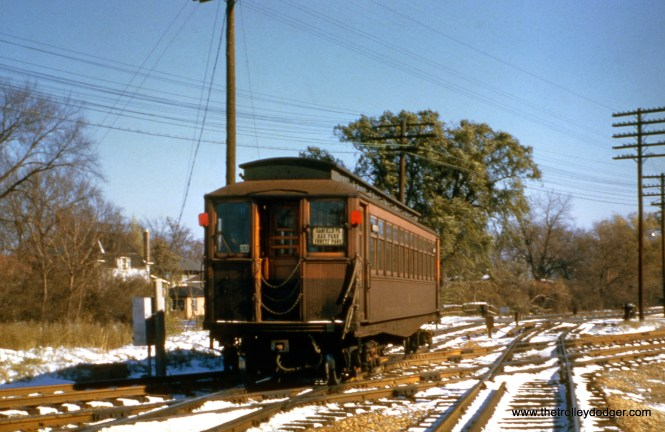 """A westbound Garfield Park """"Met"""" car crosses the B&OCT tracks in Forest Park."""