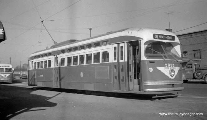 CTA Postwar PCC 7053 is signed for Route 38 in this November 1952 view. This designation was used for Route 4 - Cottage Grove cars to indicate they were terminating at Grand and Wabash. As you can see, some postwar cars were used on Cottage, and this one appears to have been converted to one-man operation.