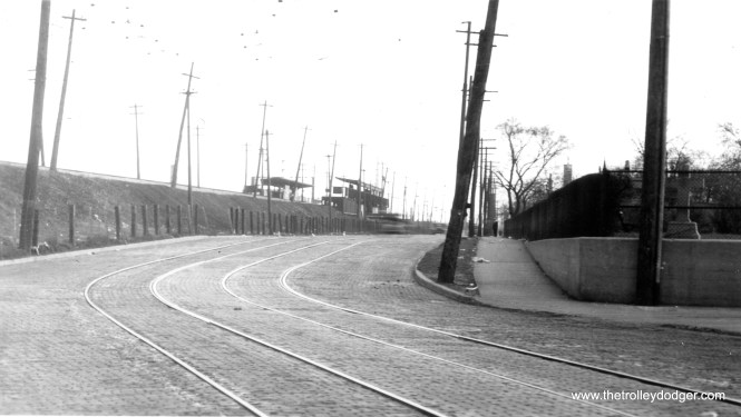 "This is an unusual picture, as it shows the Calvary ""L"" station in Evanston, which was a flag stop in both directions. Located opposite the entrance to Calvary cemetery, this station closed in 1931 and was replaced by South Boulevard a few blocks north. This view looks north from the southern edge of the cemetery. As you can see, the platforms appear relatively short. They were removed in the 1930s, but the rest of the station was not demolished until 1995. This photo probably dates to around 1930."
