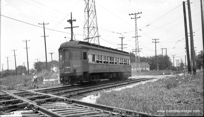 "Chicago Aurora & Elgin car 403 ""coming into Aurora from Wheaton (stopped to let off passengers)."" This picture was taken on Wednesday afternoon, July 14, 1954. (Robert Selle Photo)"