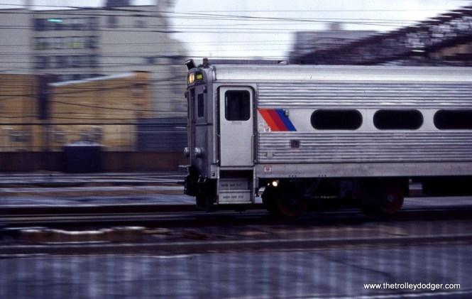 Photo 13. An Arrow III MU train departs Hoboken Terminal in this low light pan shot. 3-11-00.