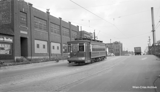 """The note that came with this image of CTA Pullman 469 says it is on Kedzie near Chicago Avenue. But the sign on the streetcar says route 66, which is Chicago and not Kedzie. So perhaps we are on Chicago Avenue near Kedzie. (Robert Selle Photo, Wien-Criss Archive) Patrick Cunningham adds: """"The Pullman 469 photo is on Chicago Ave. looking east from the CNW viaduct towards Sacramento. The building in the far background still exists."""""""