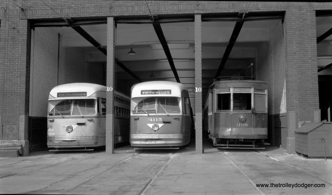 Two CTA PCCs (4064 and 4115) and red car 368, all Pullmans, at Kedzie Station (Fifth and Kedzie) on August 22, 1953. The main portion of Route 20 - Madison was converted to bus on December 13 of that year, and the Fifth Avenue branch continued for a few more months as a shuttle operation. The PCC at left is in its original colors (Mercury Green, Croydon Cream and Swamp Holly Orange), while the one in the center has been repainted in Everglade Green and Alpine White. (Robert Selle Photo)
