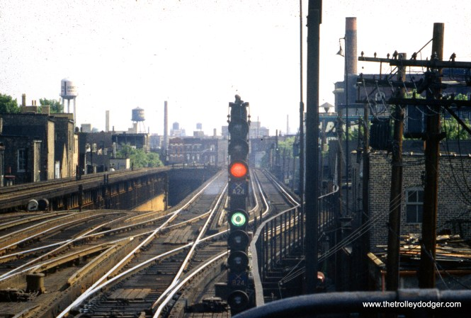 """In the center, we see the portal at the north end of the State Street subway, just south of Armitage. The two middle """"L"""" tracks were moved to the outer edge of the structure when the subway was built. The """"L"""" continued south from this point with four tracks to Chicago Avenue. In recent years, the two outer tracks have been removed, and just a siding remains at this point."""
