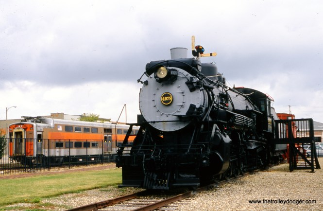 """Chicago, Burlington & Qunict locomotive 4978 in Mendota, IL on September 2, 2010 with a Metra Electric (ex-Illinois Central """"Highliner"""" at left. Both are at the Union Depot Railroad Museum. (Mike Sosalla Photo)"""