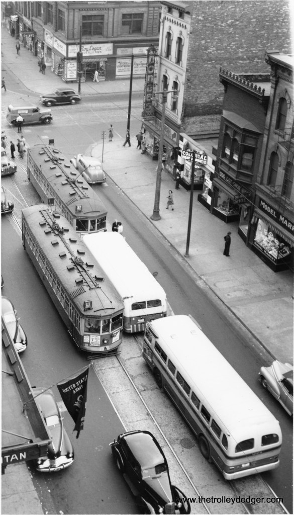 Two 800's and two Twin Coach buses meet at 3rd and State. (Robert Genack collection)