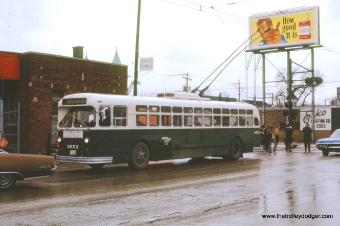 CTA trolley bus 9553 is on its last run, a fan trip held on April 1, 1973. Here it is on Fullerton Avenue near the Milwaukee Road freight line. This was one week after trolley buses were taken out of service.