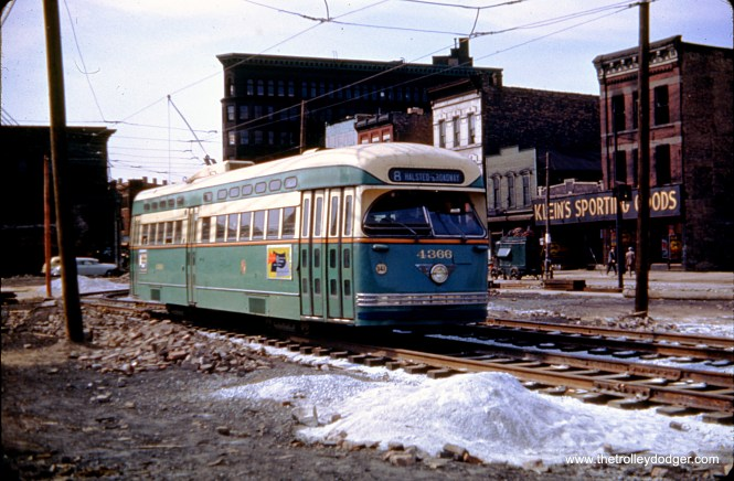 CTA PCC 4366, a Pullman, heads north on diversion trackage on Halsted at Congress in 1950. This was necessitated by construction of the bridge that would go over the Congress expressway (now the Eisenhower, I290). Bridges that crossed the highway were the first things built, since traffic could be routed around them. Once a bridge was finished, the area around it could be dug out.