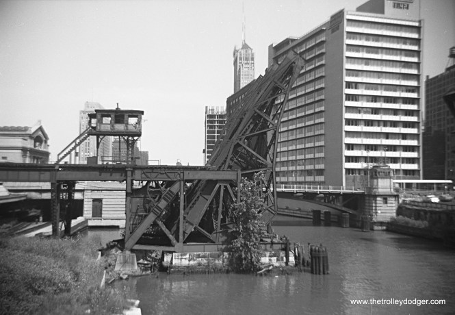 """The old Metropolitan """"L"""" crossed the Chicago River just south of Union Station (just visible at left) and had four tracks, necessitating two bridges. After these tracks were taken out of service in June 1958, the bridges were permanently raised, and razed in 1964."""