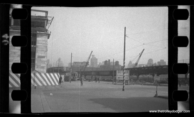 """This picture, which could be as old as the 1930s, was listed by the seller as being Chicago. However, I have my doubts, as I am unable to think of a location this could be around here, or what the construction project might be. The sign says """"Detour to temporary bridge."""" Jeff Wien thinks this might be Philadelphia."""