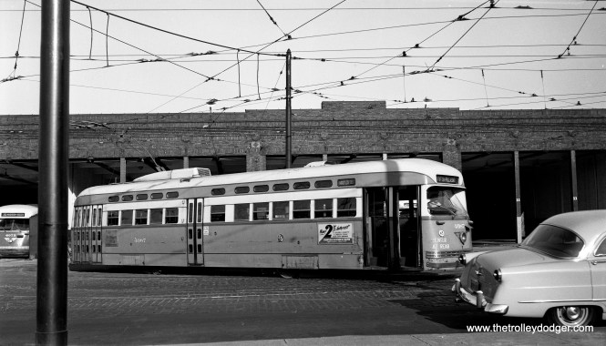 CTA PCC 4087 leaves the Kedzie car barn during the morning rush on July 1, 1953 and is signed for the Madison-Fifth branch line. (Robert Selle Photo)