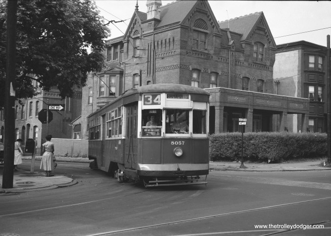 """PTC """"Peter Witt"""" 8057 was built by Brill in 1923. Here it is seen on Route 34 in the 1950s. Michael T. Greene writes: """"The picture of the Route 34 Peter Witt was taken at 38th and Locust Streets, on what's now the campus of the University of Pennsylvania. (An alum now resides at 1600 Pennsylvania Avenue, NW, in Washington, but enough of that!). The trolley is using detour trackage onto Locust Street EB, as part of the subway-surface extension of the 1950's…westbound trackage continued on Locust to 40th Street, where it hung a left turn. Today, 38th Street has been widened to a 2-way street, but still with a trolley track, used as a diversion route for subway-surface Routes 11, 13, 34, and 36. Locust Street was been turned into a pedestrian walkway, and a pedestrian bridge goes over 38th Street these days."""""""