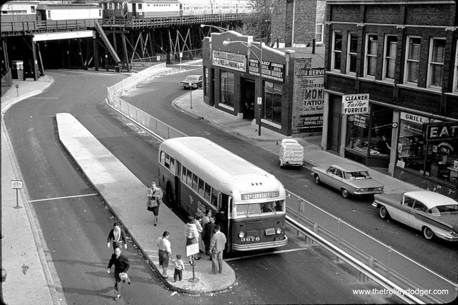 "This image, showing CTA bus 3676 on Route 82A, was not identified, but it clearly shows the Logan Square ""L"" terminal with connecting bus transfer area in the early 1960s."