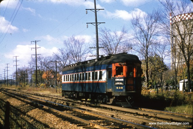 Chicago Aurora & Elgin car 419 is eastbound west of DesPlaines Avenue in Forest Park in November 1951. The gas holder, at right, was a local landmark for many years.