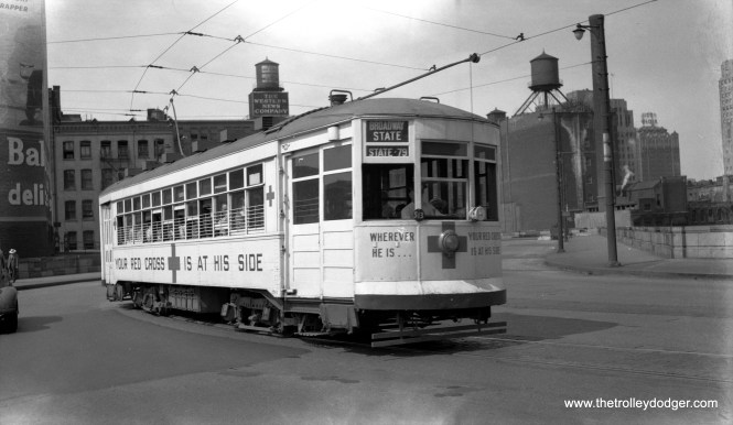 The Chicago Surface Lines decorated several of its streetcars for patriotic purposes during World War II, but here we see 1741 postwar on March 19, 1946, promoting the American Red Cross. I believe this southbound Broadway-State car is operating on Wabash just north of the Chicago River, as the new State Street bridge did not open until 1949.