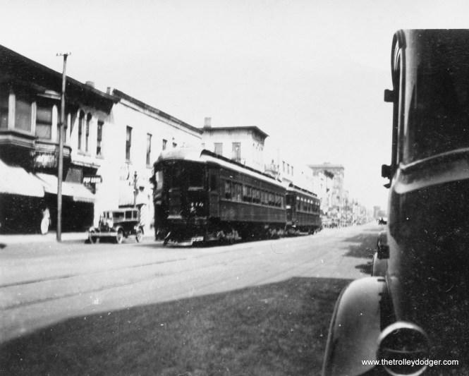 CA&E Elgin train on street in Aurora IL 1931