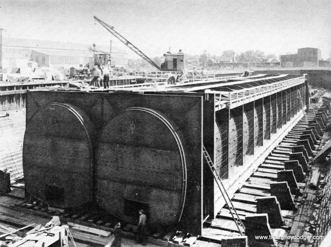 The two steel tubes for the State Street Subway's crossing of the Chicago River, before they were sunk into place in 1939.