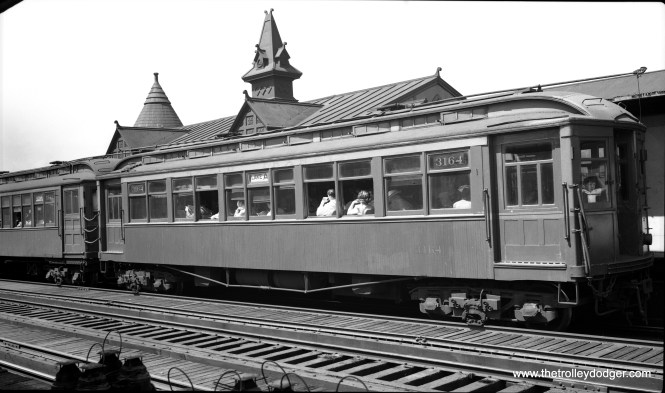 """CTA 3164 is at the Hamlin station on the Lake Street """"L"""" in August 1948."""
