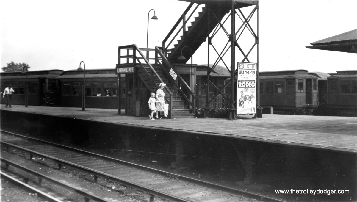"""Riders at the old Laramie stop on the CTA's Garfield Park """"L"""" in 1947. Met cars are seen in storage in the background. (John Gibb Smith, Jr. Photo)"""