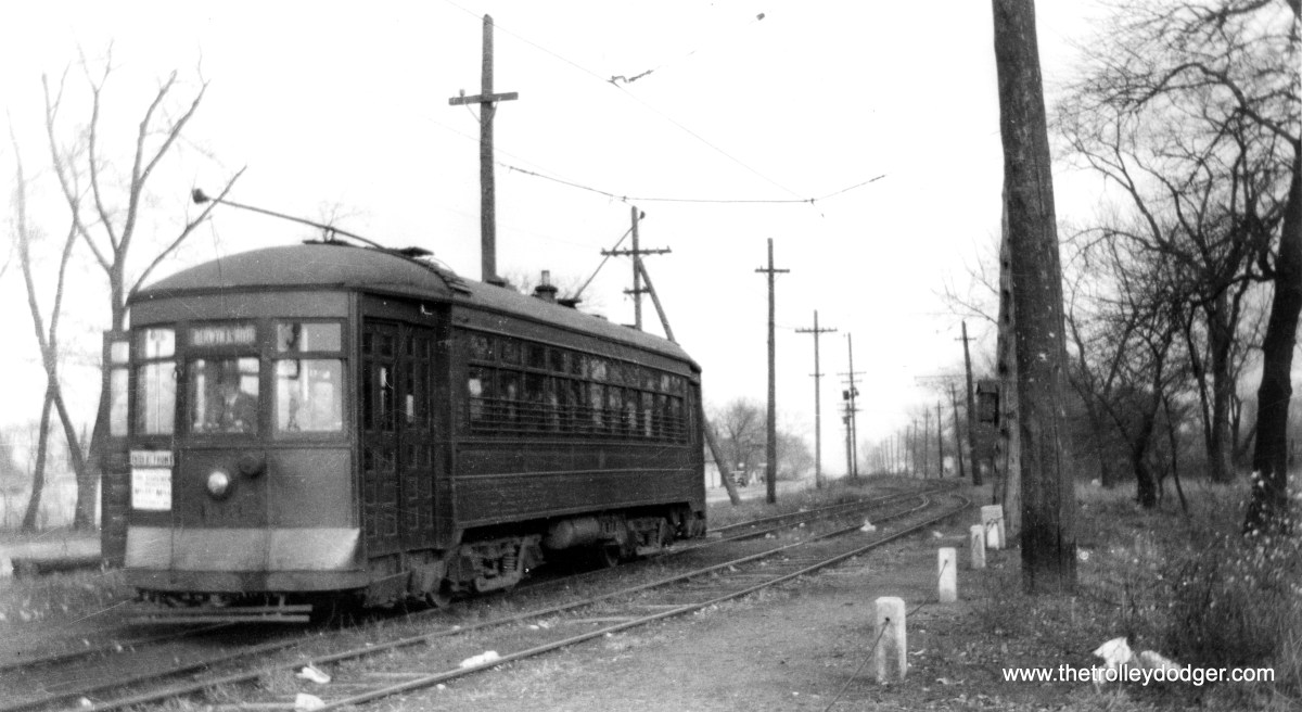"""A C&WT streetcar in LaGrange. (William Shapotkin Collection) Michael Murray: """"Photo 11, which you have captioned as """"A C&WT streetcar in LaGrange"""" is found on page 129 of the Buckley book, and is captioned: """"Between Harlem Ave and the Des Plaines River, the Berwyn-Lyons streetcar line was built on private right-of-way on the south side of Ogden Ave. It was abandoned October 26, 1933 because the land was wanted to widen Ogden Ave. The railway here was single track with two passing sidings. Car 133 was photographed on the passing siding near the Des Plaines River in October 1933, a few days before abandonment."""""""