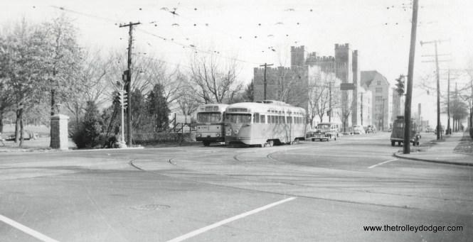 A Capital Transit PCC and bus at Catholic University in the Washington, DC area.