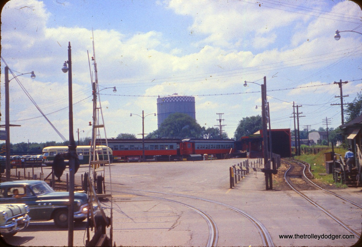 The CTA DesPlaines Avenue terminal in Forest Park in July 1955. This is an unusal view, looking west from Desplaines Avenue. At left, you can just barely see some streetcar tracks, which were used by West Towns Railways trolleys no later than 1948. That could be a CTA Route 17 bus, and you can also see some Chicago, Aurora & Elgin interurban cars in the station. The CA&E cut back service to here in 1953.