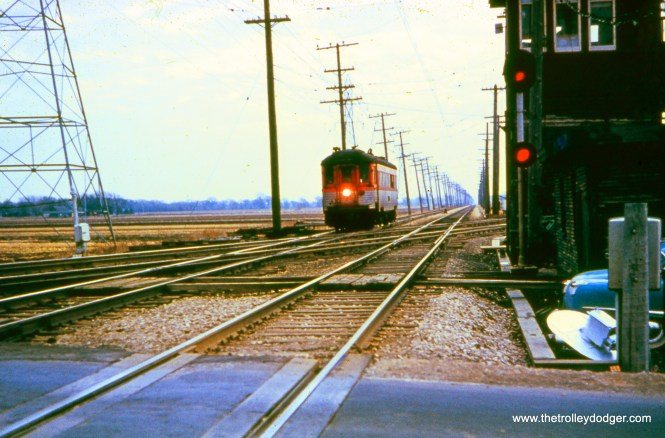 Near the Milwaukee County line, a North Shore car crosses the C&NW freight line at an acute angle. (A. C. Kalmbach Photo, William Shapotkin Collection)