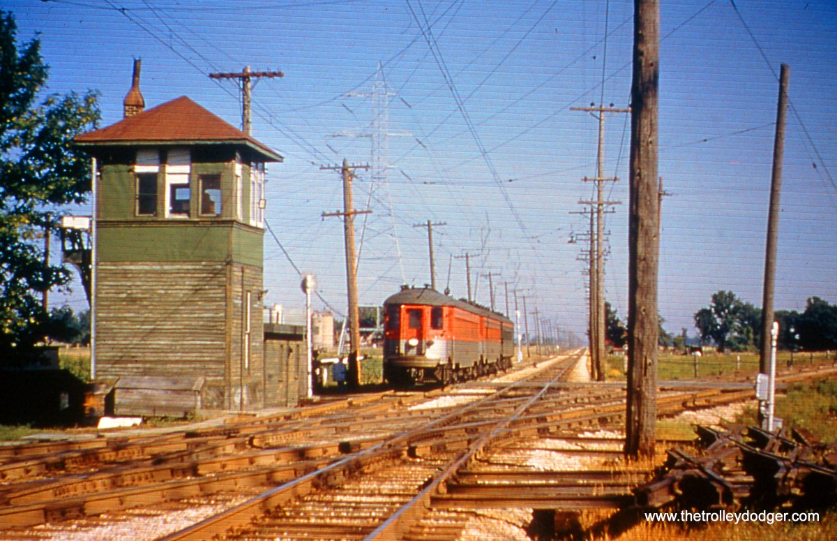 """Milwaukee County, WI - In 1958, a southbound CNS&M passenger train approaches the crossing with C&NW """"New Line"""" at Ryan Road (that's Ryan Tower at left). The view looks north. (William Shapotkin Collection)"""