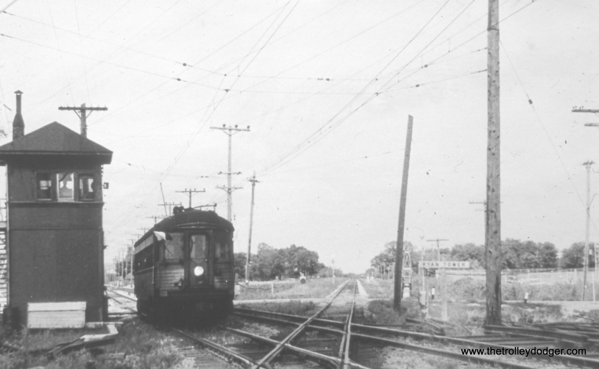 "Milwaukee County, WI - A southbound CNS&M ""Silverliner"" (in fantrip service) is about to cross over the (now single-track) C&NW ""New Line"" at Ryan Tower. View looks north. (William Shapotkin Collection)"