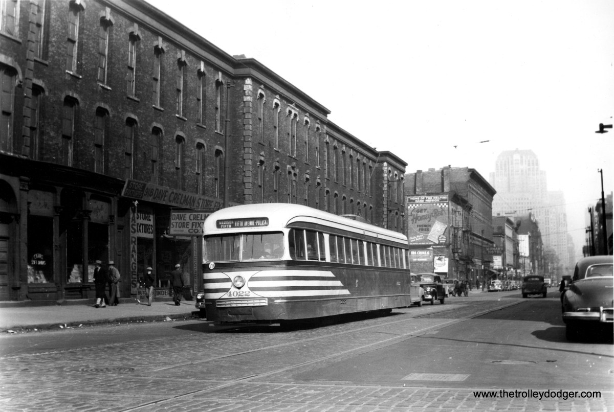 """CSL prewar PCC 4022 heads west on Madison Street in the late 1940s. It is signed for the Madison-Fifth branch line. Fifth Avenue is an angle street that heads southwest. Service on the branch line terminated at the Garfield Park """"L"""" station at Pulaski Road. Several parts of Fifth Avenue have been truncated since streetcars stopped running their in early 1954. (Edward Frank, Jr. Photo)"""