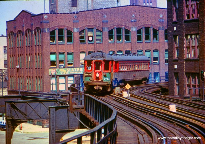 CNS&M 741 heads up a two-car train approaching the Merchandise Mart in July 1962.