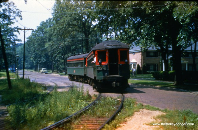 This shows a North Shore Line interurban train turning south from Greenleaf Avenue in Wilmette between 4th and 3rd. After making a station stop, the NSL continued south into Chicago via CTA trackage starting at Linden Avenue. This picture was taken on July 17, 1955 by the late Joseph M. Canfield, just one week before service was abandoned on the NSL's Shore Line Route. The CTA section of the route was connected to NSL trackage that ran parallel to the Chicago & North Western by several blocks of street running through a residential neighborhood, where speed was restricted to (I think) 10 mph. Some blocks west of here, the trains turned north in an area that is currently occupied by a Panera (and, before that, one of those A-frame IHOPs). I have included a Google street view photo of the same location. The North Shore Line ran in the section where you can see the street widens.