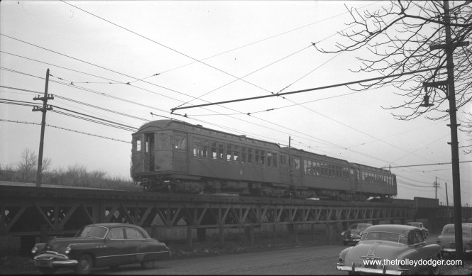 A three-car train of CTA 1700-series RR roof