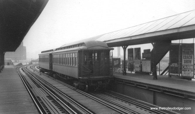 "A two-car train of CRT gate cars at Halsted on the Stock Yards branch of the ""L"". This picture can be dated to about March 1946 from the advertising posters. The Olsen and Johnson comedy team, of Hellzapoppin' fame, were appearing at the Schubert Theater in Laffing Room Only."