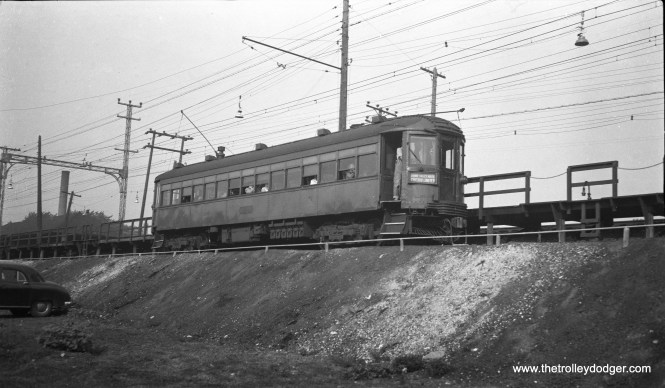 "The caption I received with this North Shore Line negative reads, ""Single car Skokie (Valley) inbound 1950s Chicago Limited, at a platform on embankment looking up."""