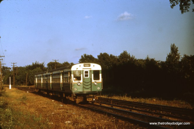 """Here is an example of some early """"flat door"""" 6000s running in the 1950s, on the outer portions of the old Garfield Park """"L"""". I am not sure whether this picture was taken in Forest Park, just east of DesPlaines Avenue (near where the """"L"""" crossed the B&OCT), or along the south edge of Columbus Park a few miles further east."""