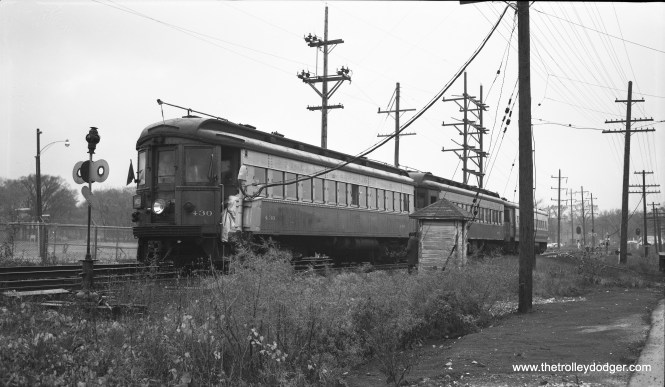 After passenger service on the CA&E ended abruptly on July 3, 1957, there were still a few fantrips held. Here is one such train on October 26, 1958. We see cars 430, 403(?), and 453 east of First Avenue near Maywood. The conductor in this Bob Selle photo is climbing aboard at a switch. Presumably, this is as far east as CA&E trains could go at the time, since what is now I-290 was under construction where the interurban once crossed the DesPlaines River. The CA&E's bridge was dutifully moved to the north a bit, and new tracks leading to the DesPlaines terminal built by 1959, with no trains ever to run on them.