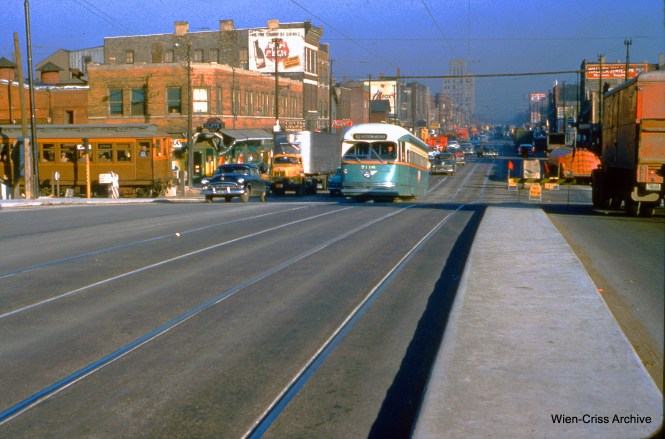 "CTA 7118 is southbound on Western at Van Buren on November 3, 1954, with a train of wooden ""L"" cars about to cross Western on the temporary right of way for the Garfield Park ""L"" during expressway construction. (Wien-Criss Archive)"