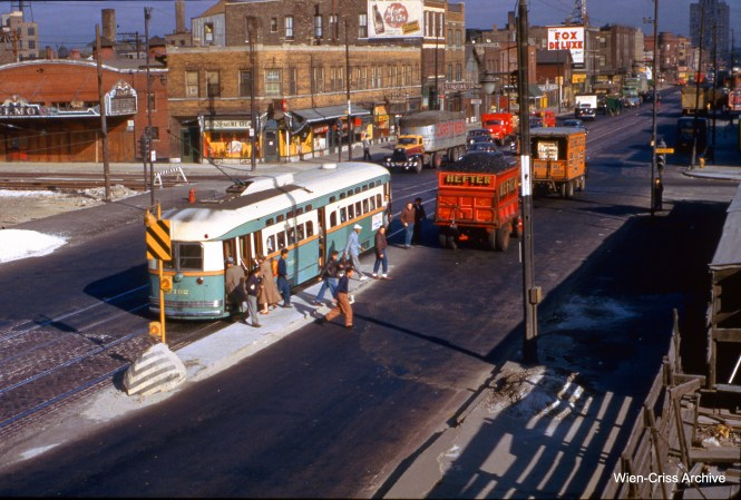 "Passengers are getting off northbound CTA 7192 at Western and Van Buren on October 10, 1952. At this time, the temporary Van Buren trackage was still under construction, and this picture was taken from the Garfield Park ""L"" station, then still in use. There is no shoo-fly yet, meaning construction had not yet started on the Western Avenue bridge that would eventually go over the Congress Expressway. (Wien-Criss Archive)"