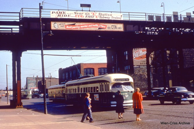 "CTA 7238 is southbound on Western at the Douglas Park ""L"" on April 22, 1955. (Wien-Criss Archive)"