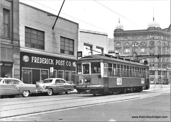 M&STC 978 EB on Wells St. between Milw. River and N. Water St. Summer, '57 Ernie Maragos photo