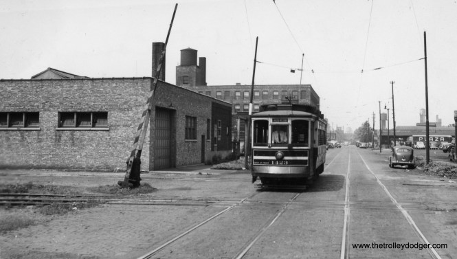 "Chicago Surface Lines ""Matchbox"" 1423 is heading towards Fulton and Western. The notation on the back of the photograph says Fulton-21st-Canal. (William Shapotkin Collection) Andre Kristopans adds, ""The Fulton-21 shot looks to be 21st and Sangamon, crossing the Burlington branch that came off the main at 16th and followed Sangamon down to the Lumber District line at Cermak. Mostly ripped up maybe 10 years ago. Lumber District line itself is barely alive with only one or two customers left."""