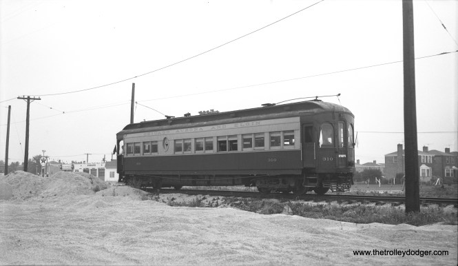 Bob Selle took this picture on August 8, 1954, during a Central Electric Railfans' Association fantrip on the Chicago Aurora and Elgin interurban, using wood car 310. This was a photo stop on the freight-only Mt. Carmel branch, which ran alongside Mannheim Road. Mr. Selle identified this location as a quarry, but it would be interesting to know just how far south this was. It may be possible to determine this from the location of the houses at right, assuming they are still there. As far as I know, tracks at this time ended just south of Roosevelt Road and had once served the cemetery there.