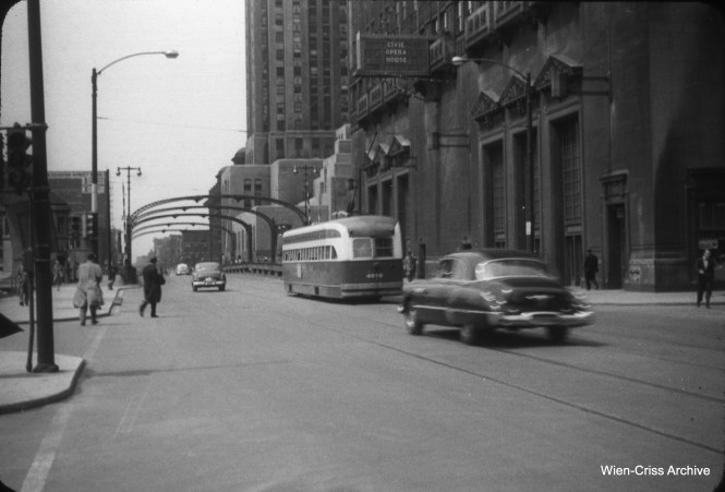 On May 1, 1953, PCC 4070 is westbound on Madison Street, looking west from Wacker Drive with the Civic Opera House at right. The streetcar is about to cross the Chicago River. (William C. Hoffman Photo, Wien-Criss Archive)