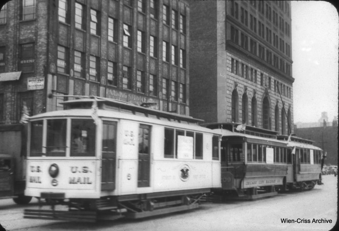 Some old CSL streetcars, including mail car 6, are shown at 11th and State in 1948 as part of a parade. The mail car is now at the Fox River Trolley Museum. (William C. Hoffman Photo, Wien-Criss Archive)