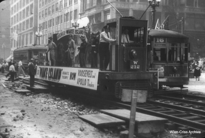 On September 14, 1942, construction was well underway for Chicago's first subway at State and Washington (the tunnels were already finished, and here they were building the station using the cut-and-cover method). Work car W212 is being used to promote the patriotic film Wake Island. (William C. Hoffman Photo, Wien-Criss Archive)