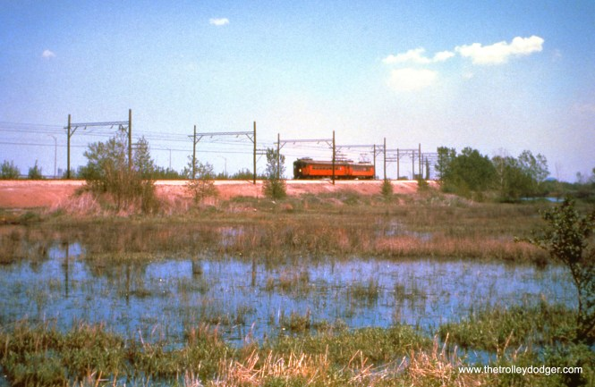 A westbound two-car South Shore Line train is on the 130th Street curve, two miles east of Kensington, in October 1966. (John D. Horachek Photo, William Shapotkin Collection)