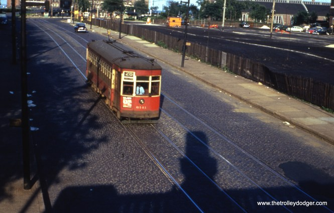 CTA 6141, working a southbound trip on Route 28 - Stony Island, is westbound on grand Avenue approaching Lake Shore Drive, having just departed the north end of the line at Navy Pier, on August 5, 1952. (William Shapotkin Collection)